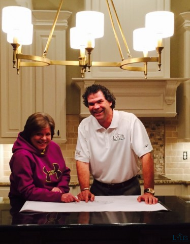 Gary Lyles owner/project manager and future custom home owner reviewing final plans