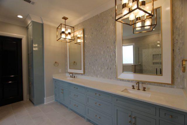Master bath with designer lighting, designer custom framed mirrors ...