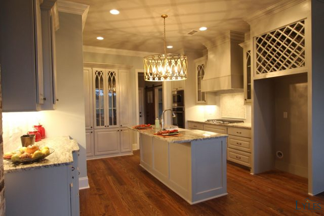 Open Concept Kitchen With A Prep Island And Sink Pine