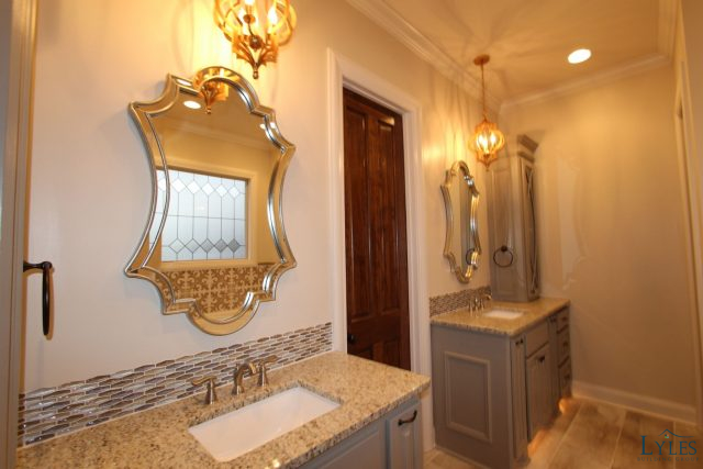 Master bath with double vanities and custom framed mirrors. • Lyles ...