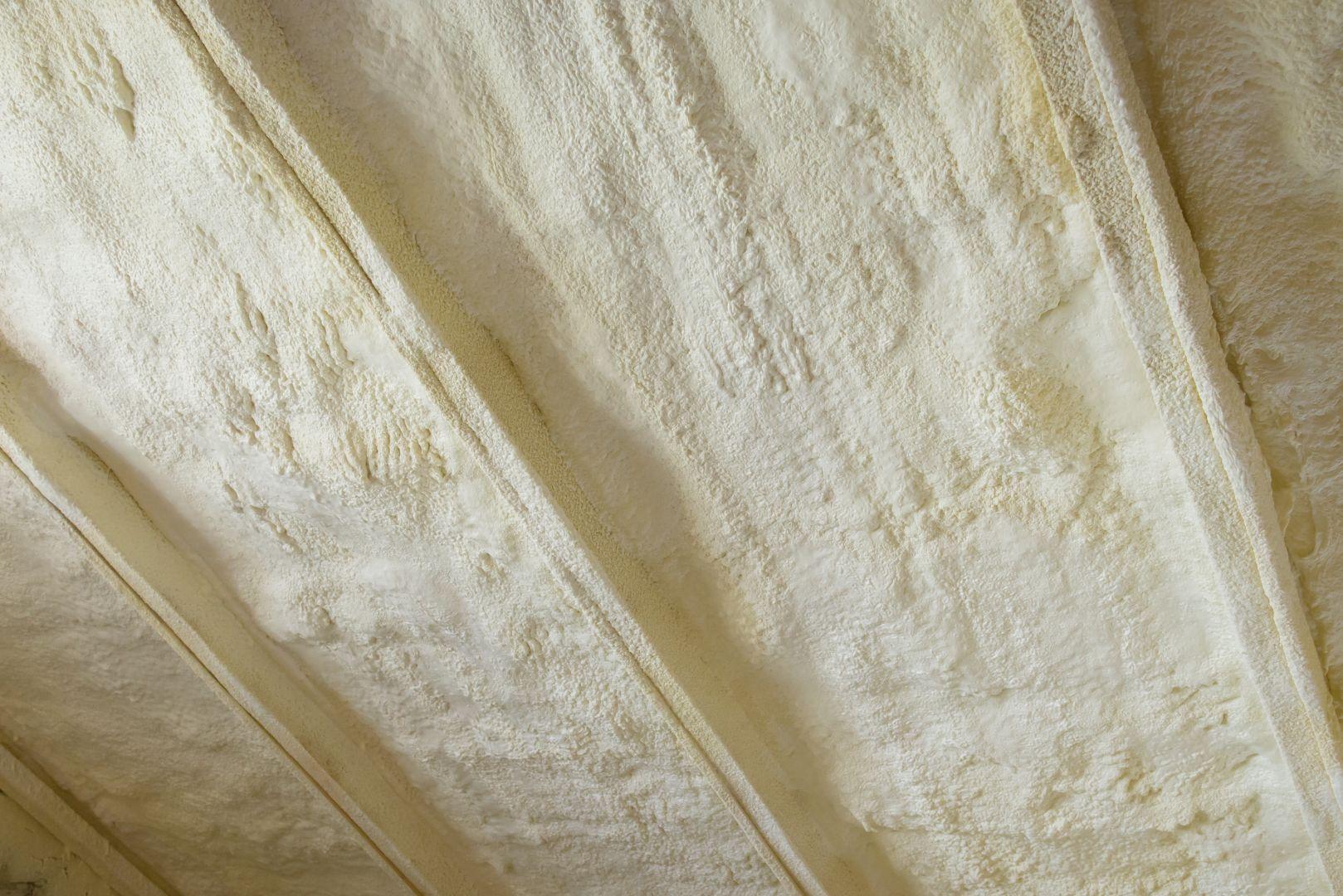 polyureathane spray foam insulation between studs