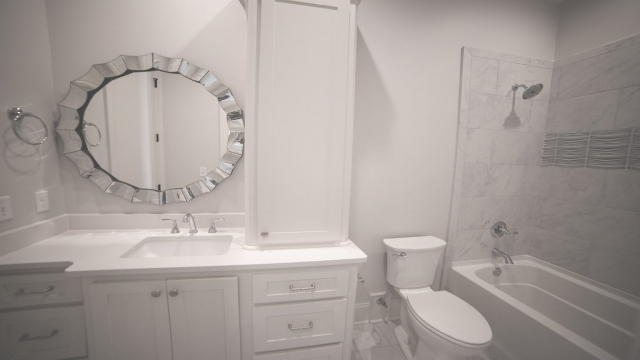 Guest bath with custom mirror northshore landing brandon mississippi