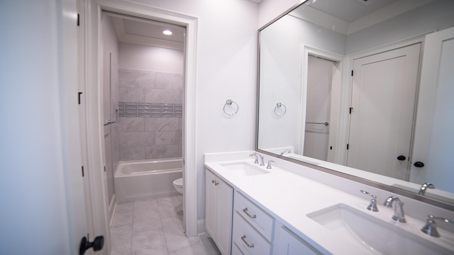 Guest bath with custom shower tile northshore landing brandon mississippi