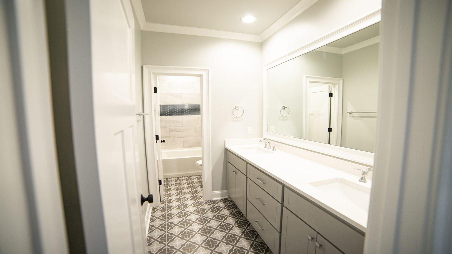dual vanities guest bath mosaic tile flooring tile shower surround brandon mississippi