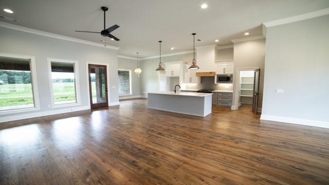 wood floors kitchen island copper light fixtures modern fan brandon mississippi