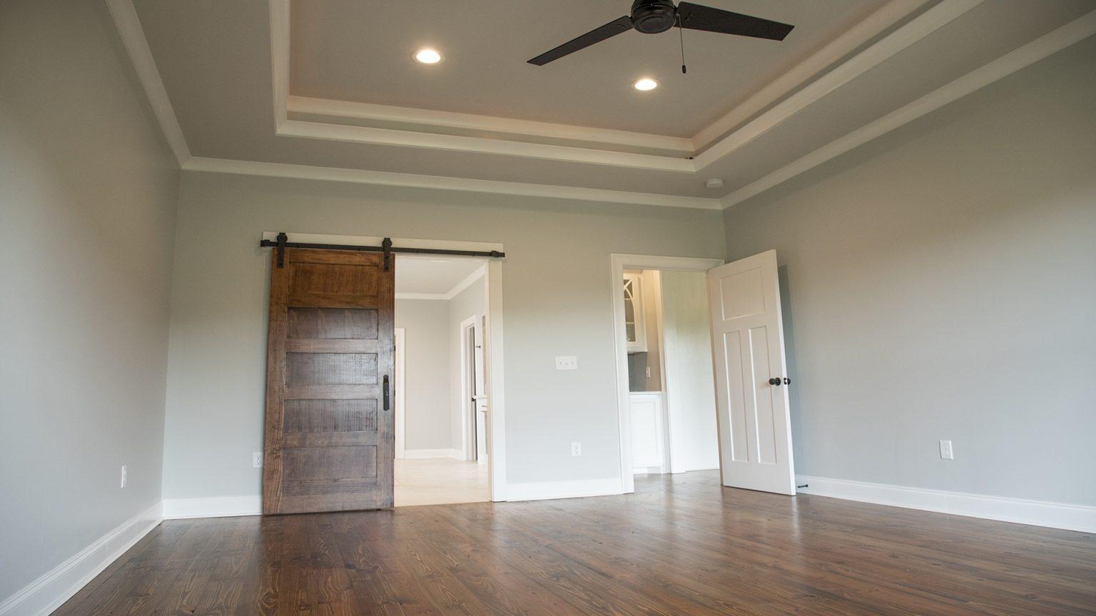 master bedroom tray ceiling indirect lighting barn door modern fan brandon mississippi