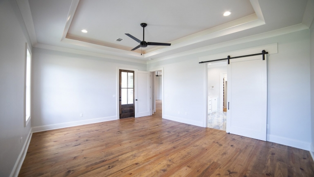 tray ceiling indirect lighting barn door master bedroom brandon mississippi