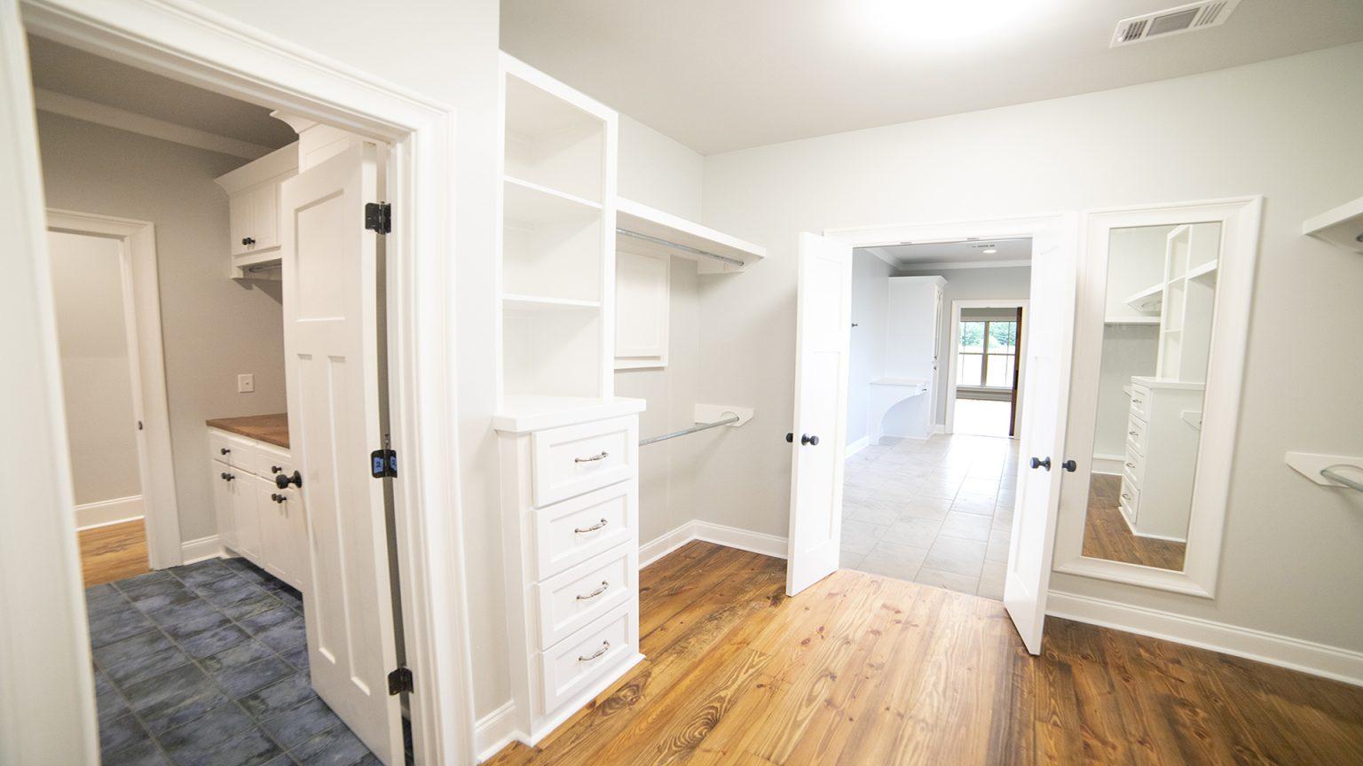 master closet built ins custom chest of drawers blue tile floor wood flooring brandon mississippi