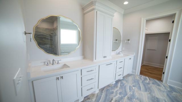 eight 8 inch spread plumbing fixtures custom gold mirrors large bath tile flooring brandon mississippi