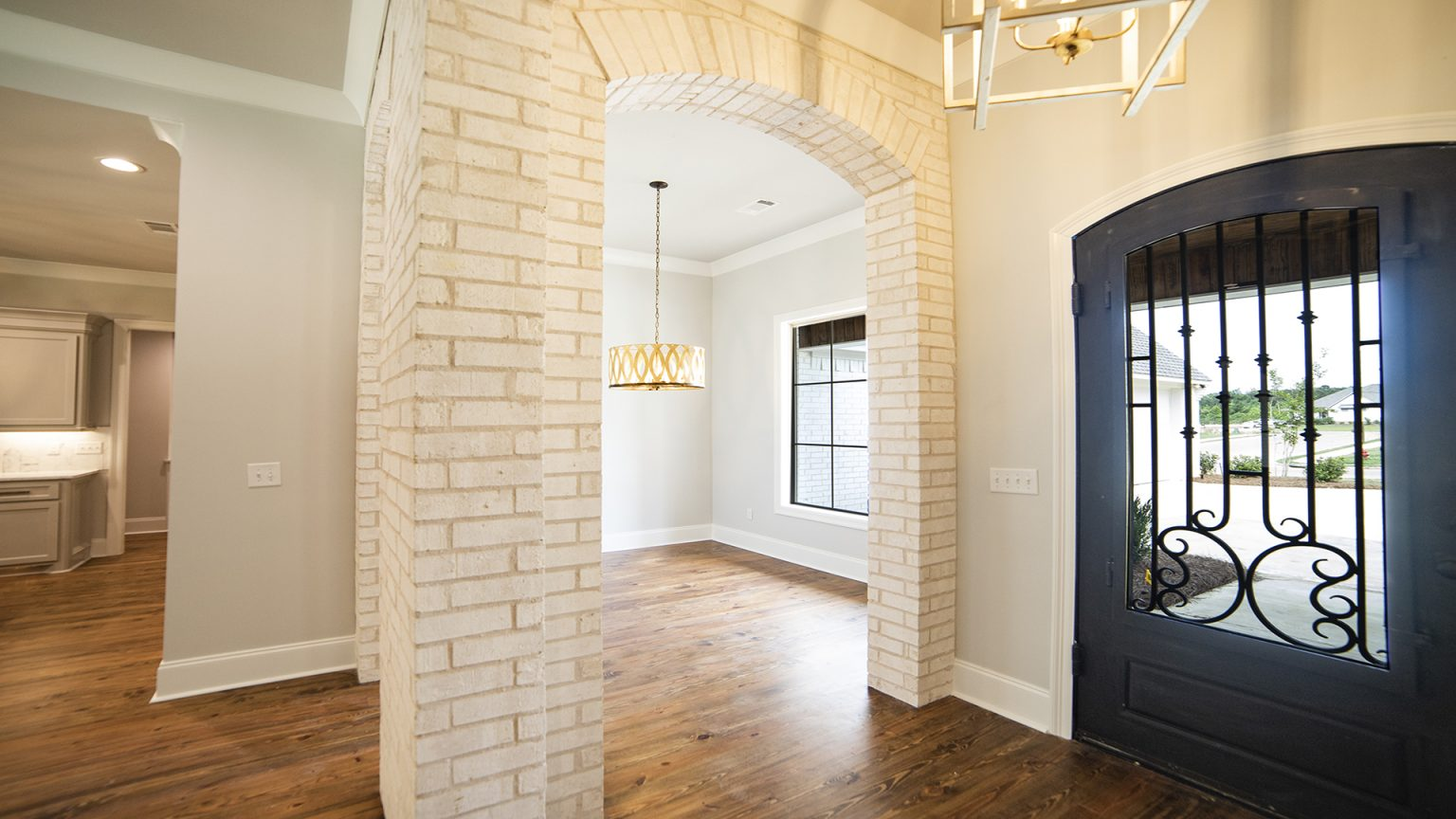 White interior brick and iron door in Flowood Mississippi